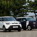 Kia Soul EV next to gasoline Soul