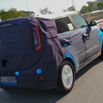 Kia Soul EV rear quarter view comouflaged