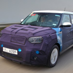 Kia Soul EV side front view camouflaged